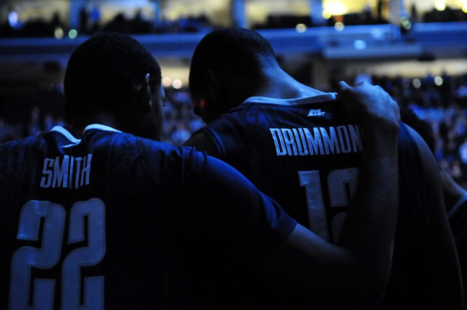UConn's Roscoe Smith puts his arm over Andre Drummond's shoulder during introductions before the game.
