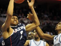 UConn&#039;s Jeremy Lamb tries to pull down a messy rebound during the first half of their basketball game against Villanova at the Wells Fargo Arena in Philadelphia. UConn missed 10 straight field goals in the first half and the game was tied at the half with 30 points.