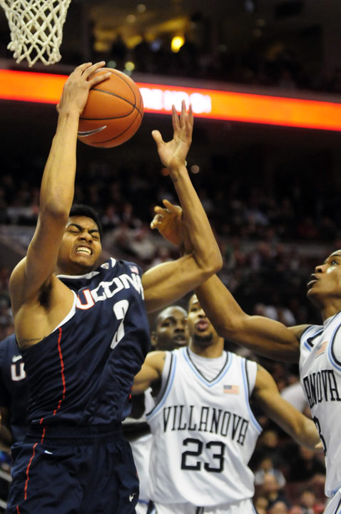 UConn's Jeremy Lamb tries to pull down a messy rebound during the first half of their basketball game against Villanova at the Wells Fargo Arena in Philadelphia. UConn missed 10 straight field goals in the first half and the game was tied at the half with 30 points.