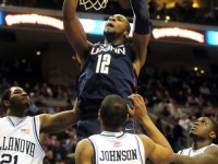 UConn's Andre Drummond dunks over Villanova's Markus Kennedy, Tyrone Johnson and Mouphtaou Yarou during the first half.