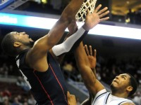 UConn&#039;s Andre Drummond puts one in over Villanova forward Markus Kennedy during the first half.