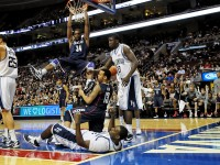 UConn's Alex Oriakhi hangs in limbo after being called for a charging foul on a dunk during the second half.