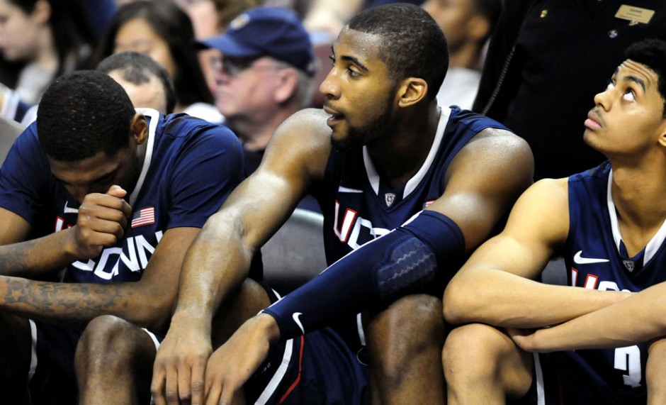 UConn's Roscoe Smith, Andre Drummond and Jeremy Lamb watch the Huskies slip behind again in the second half.