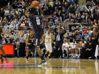 Villanova&#039;s bench goes insane as Roscoe Smith catches an in-bounds pass intended for Villanova forward JayVaughn Pinkston at mid-court, helping the Huskies to tie the score and eventually pull out a 73-70 overtime win.