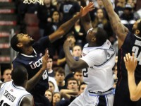 UConn's Roscoe Smith and Alex Oriakhi block Villanova forward JayVaughn Pinkston.