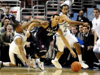 UConn's Shabazz Napier is fouled by Villanova's Tyrone Johnson, with Dominic Cheek defending (right) during the Huskies' 73-70 win over Villanova in OT.
