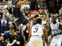 UConn&#039;s Ryan Boatright seems to make a flying leap over Villanova guard Tyrone Johnson.