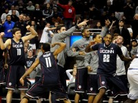 UConn&#039;s bench reacts after an out-of-bounds ball is placed in their possession during OT as the Huskies beat Villanova 73-70 at the Wells Fargo Arena.