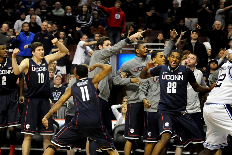 UConn's bench reacts after an out-of-bounds ball is placed in their possession during OT as the Huskies beat Villanova 73-70 at the Wells Fargo Arena.