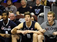 UConn&#039;s DeAndre Daniels, Tyler Olander and Niels Giffey sit with locked arms, holding their breath during free-throws in OT.