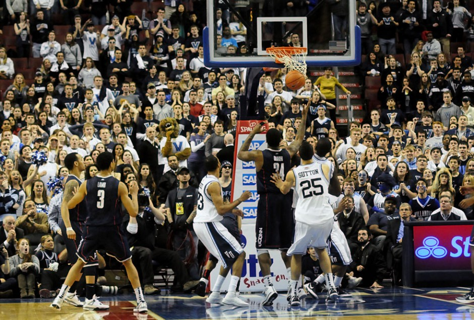 Villanova scored with seconds left in OT to tie the score before Shabazz Napier put in a buzzer-beating three to lift the Huskies' 73-70  over the Wildcats.