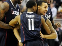 UConn's Shabazz Napier gets a huge hug from Ryan Boatright and cheers from Alex Oriakhi and Roscoe Smith after sinking his buzzer-beating shot.