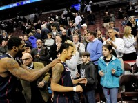 UConn's Shabazz Napier is greeted by fans with Alex Oriakhi in tow as the hero of the night. Napier sunk a three-point shot with 0.6 seconds showing on the clock to beat Villanova 73-70 in OT.