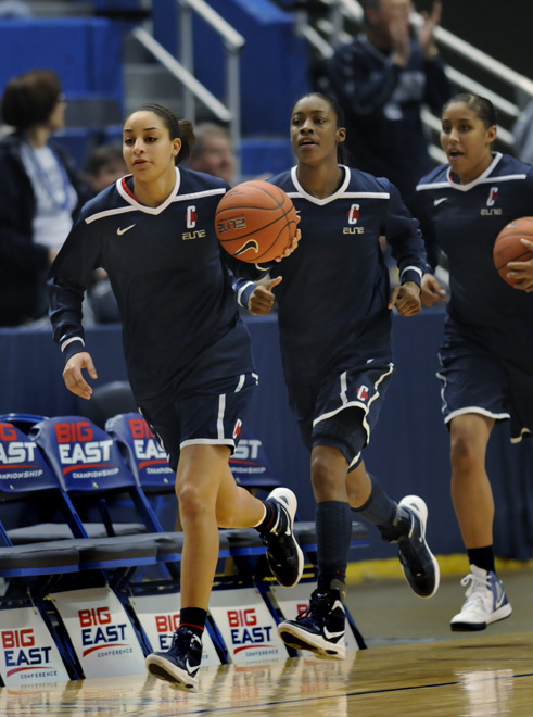 Bria Hartley leads the team onto the court before the Big East Championship game.  They wore their road uniforms and sat on the visitors bench, something they are unaccustomed to, since they were the third seed this year.o