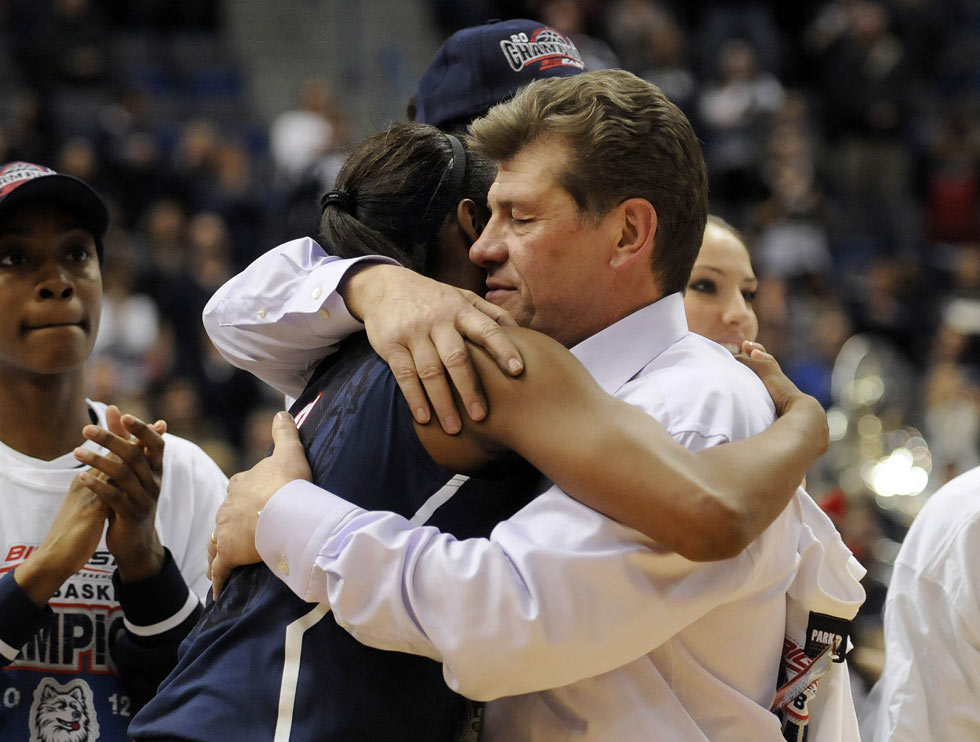 Geno Auriemma hugs senior Tiffany Hayes after UConn beat Notre Dame 63-54 to win the Big East championship. It was Auriemma's 800th career win, UConn's 18th title and Hayes' last Big East tournament.