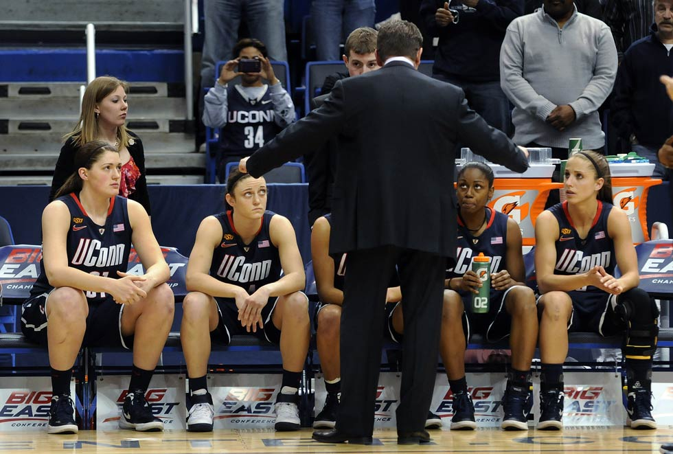 Head coach Geno Auriemma gets the attention of his starting lineup for some last minute instructions before the game.