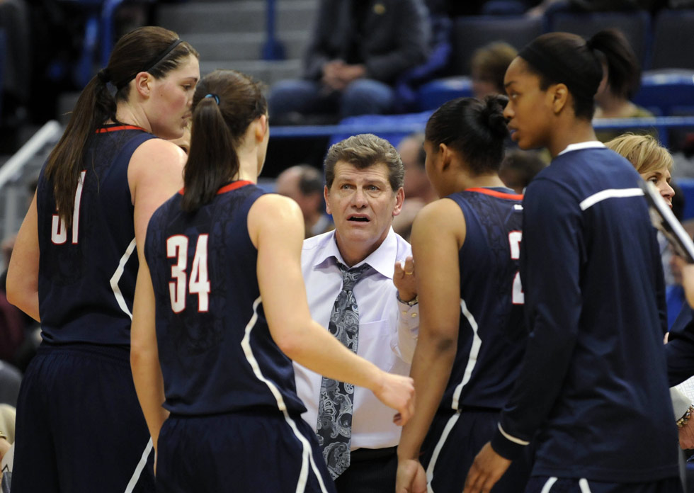 Geno Auriemma makes a point to his team during a time out.