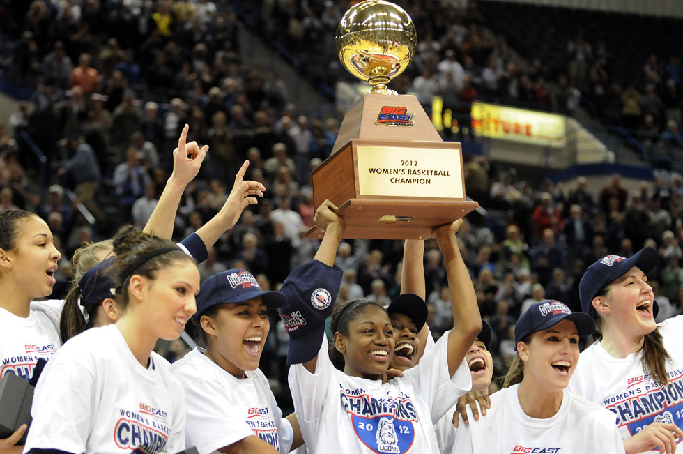 Tiffany Hayes hoists the championship trophy as she and her teammates pose for photos after their hard-fought victory.