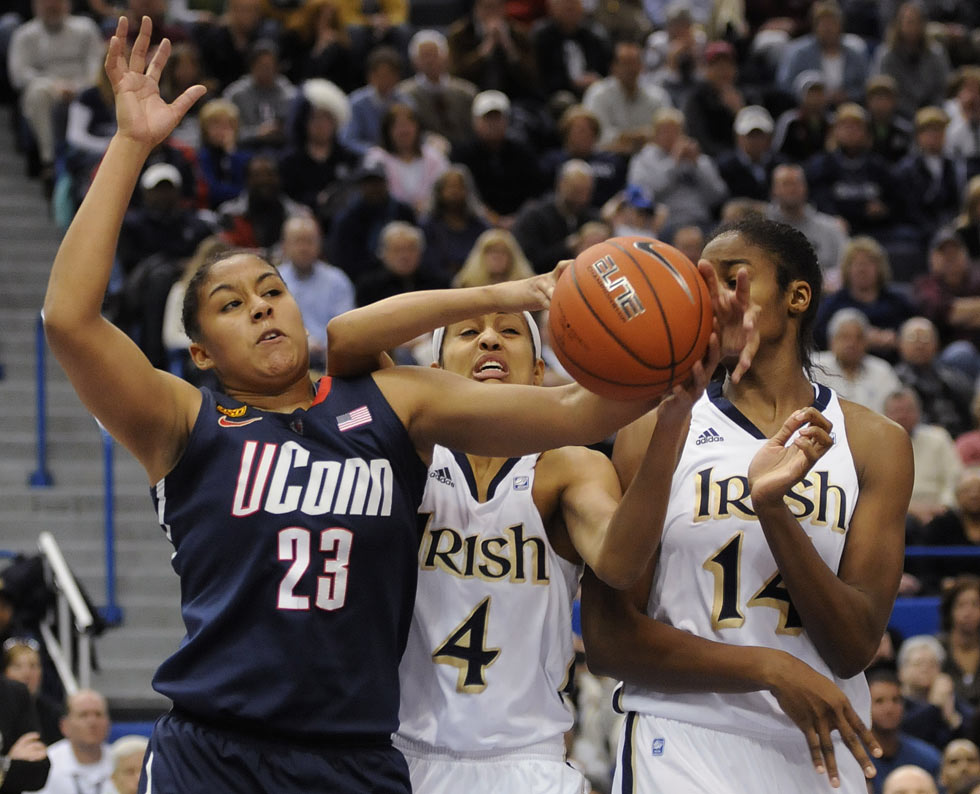 Kaleena Mosqueda-Lewis fights Notre Dame's Skylar Diggins and Devereaux Peters for a rebound in the first half.