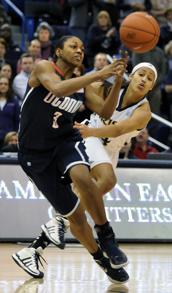 Tiffany Hayes has the ball tipped away by Notre Dame's Skylar Diggins in the first half.