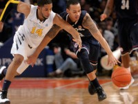 University of Connecticut sophomore guard Shabazz Napier, 13, steals the ball from West Virginia University freshman guard, Gary Browne, 14,  his first of two late game steals. On this one, he ended up scoring to bring the score to 63 to 61.