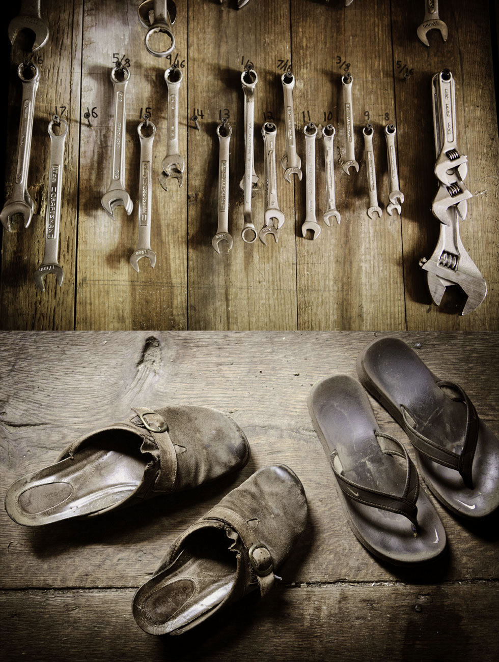 Top: Tools hang in Ed Wazer's workshop. Bottom: Family shoes rest on broad floor boards while Ed and Raluca work outside.