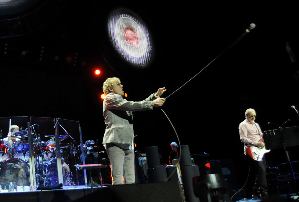 Roger Daltrey performs his signature move with his microphone on stage at Mohegan Sun.