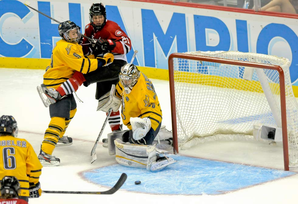 Quinnipiac goalie Eric Hartzell and his defensive teammates including Kevin Bui (9), at left, shut down Brooks Bertsch (21) and the St. Cloud State offense 4-1 in the Frozen Four semifinal game at the Consol Energy Center in Pittsburgh. Quinnipiac would face Yale in the national championship game.