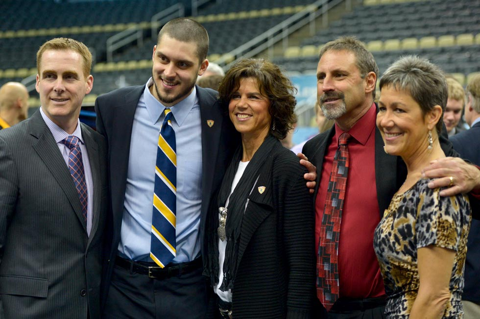 Quinnipiac goalie and Hobey Baker finalist Eric Hartzell joins his coach and family at the awards ceremony in Pittsburgh. From left is Quinnipiac head hockey coach Rand Pecknold, Hartzell and his mom Mary Beth, his dad Kevin Hartzell and at right is Hartzell's aunt, Michelle Matthews.