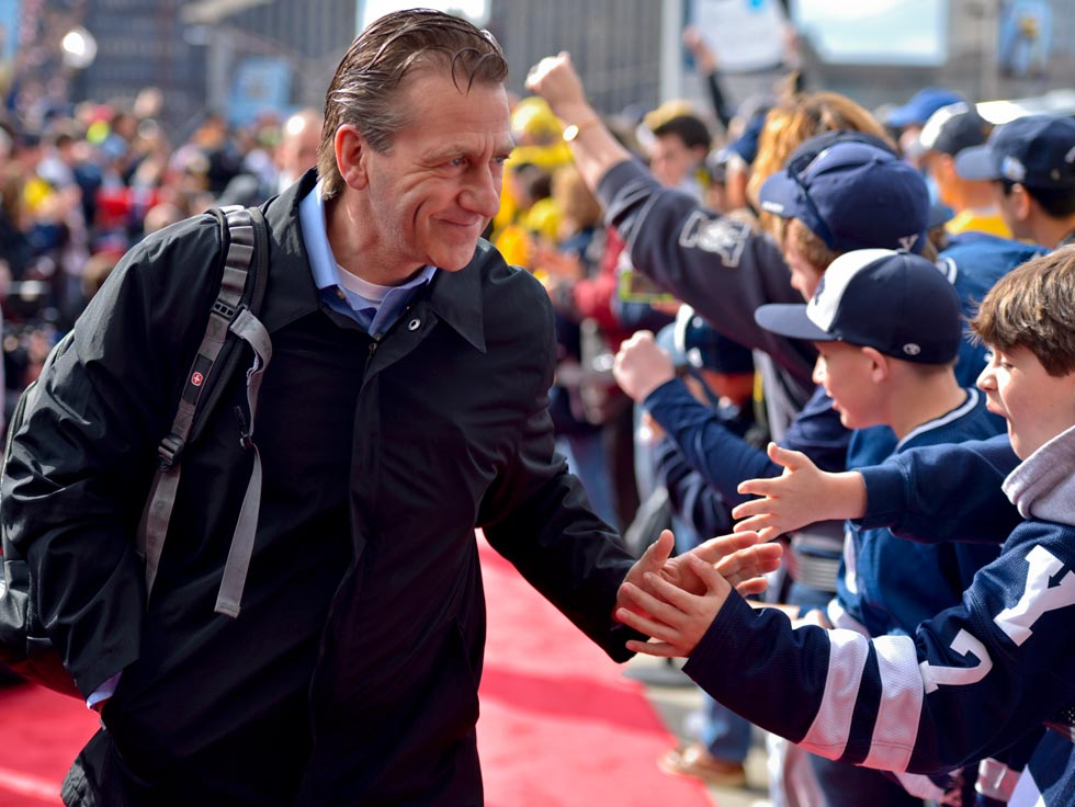 Yale head hockey coach Keith Allain leads his team into the Frozen Four championship venue at the Consol Energy Center in Pittsburgh on April 13.