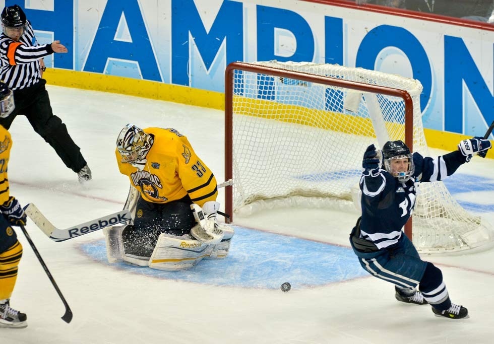 Yale captain Andrew Miller strikes again to make it 3-0 against Eric Hartzell and Quinnipiac in the third period of the Frozen Four championship game.
