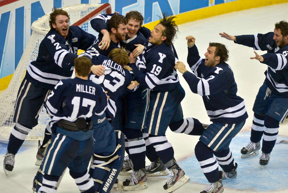 Yale celebrates it stunning 4-0 win over Quinnipiac in the Frozen Four championship game