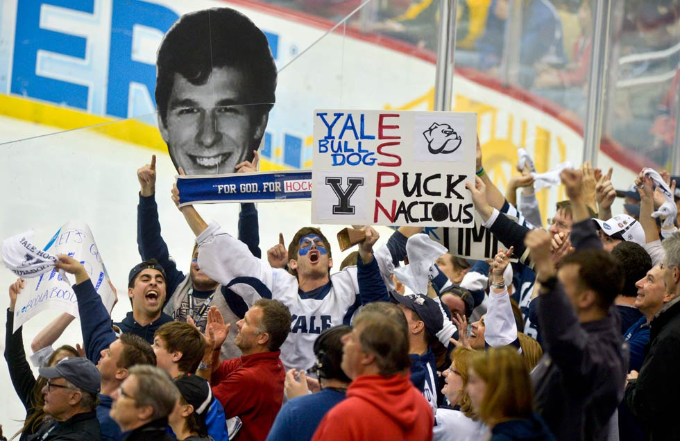 Yale fans begin to celebrate (with Yale captain Andrew Miller's likeness) in the third period as Yale's Miller opened up a 3-0 lead over Quinnipiac in the Frozen Four championship game at the Consol Energy Center in Pittsburgh.
