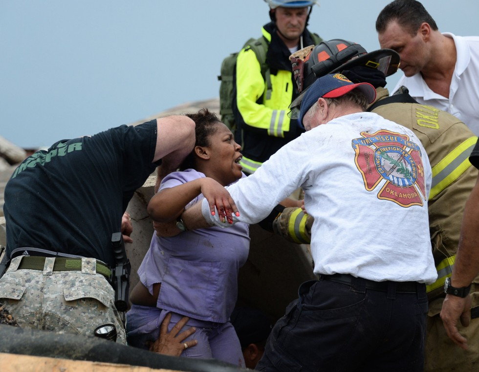 5/20/2013 -- Rescue workers help free one of the 15 people that were trapped at a medical building at the Moore hospital complex after a tornado tore through the area of Moore, Oklahoma May 20, 2013. REUTERS/Gene Blevins