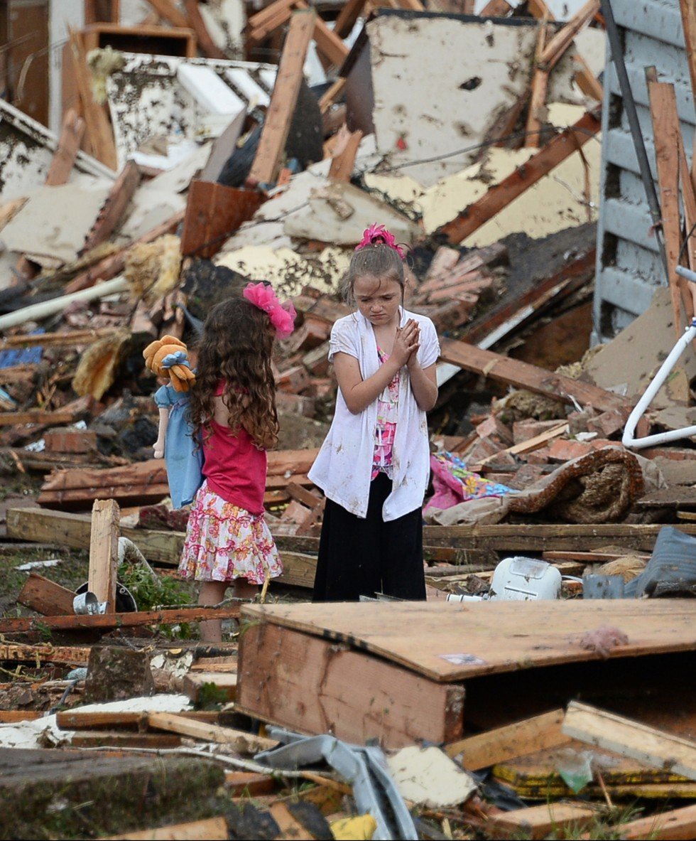 5/20/2013 -- Children look at destroyed homes in the aftermath of a huge tornado that struck Moore, Oklahoma, Monday, May 20, 2013.  Tuesday. (Gene Blevins/Zuma Press/MCT)