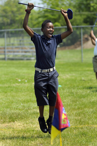 2013.05.21 - Bloomfield, CT - Lake Mclean (cq) leaps for joy after hitting the pin with his shot during the SNAG (Starting New At Golf) program at Metacomet Elementary School.