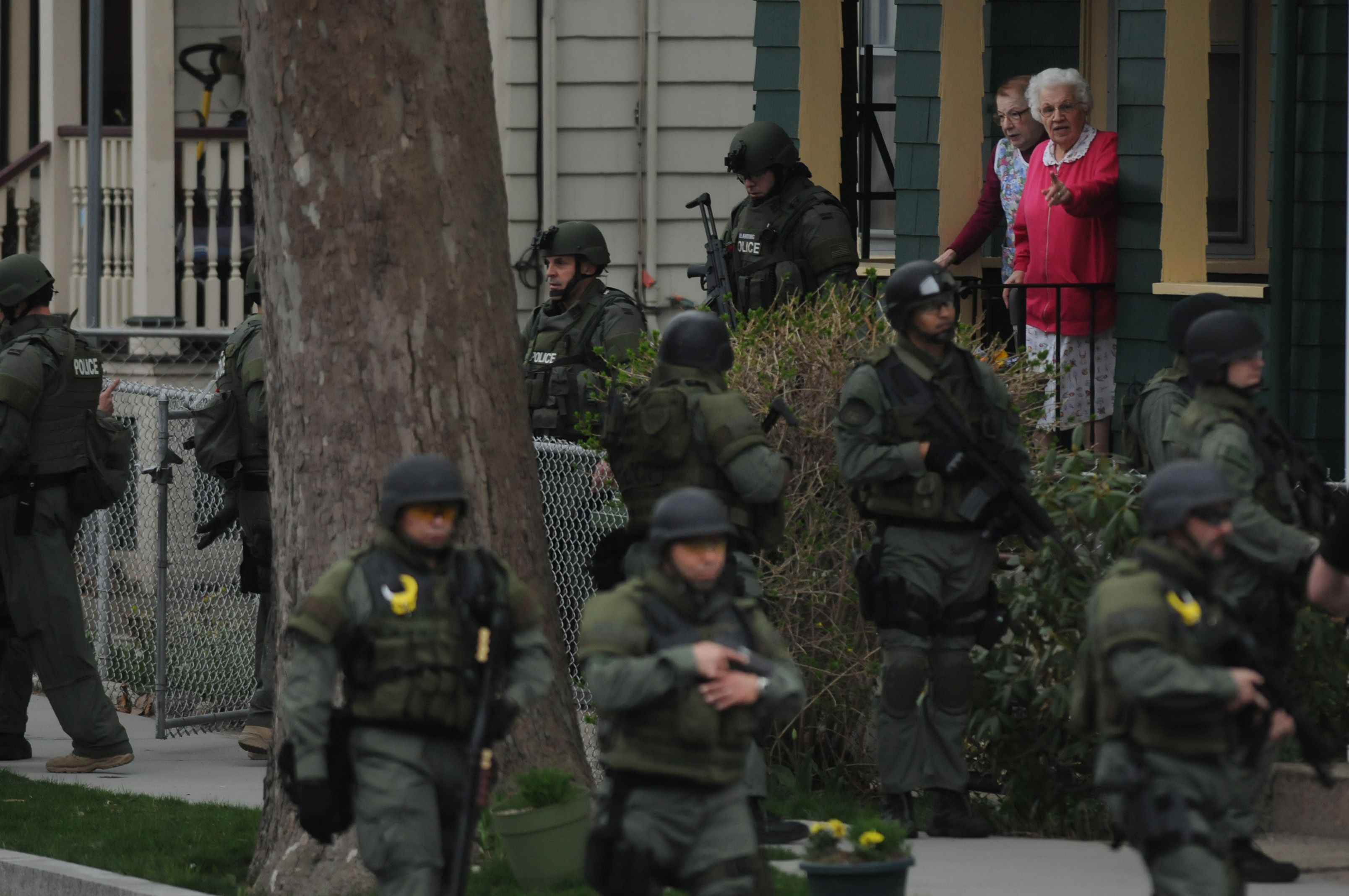 A neighborhood on Elm St. in Watertown was overrun by Police personal searching house to house for one of the brothers, Dzhokhar A. Tsarnaev, 19, suspected to be the Boston Marathon bomber, who was still on the loose.  Shots appeared to be fired as the police were in the building, but the shots apparently came from the Frankiln Street area a few blocks away. His brother, Tamerlan Tsarnaev,  was killed early Friday morning in a police shoot out in Watertown, Mass.