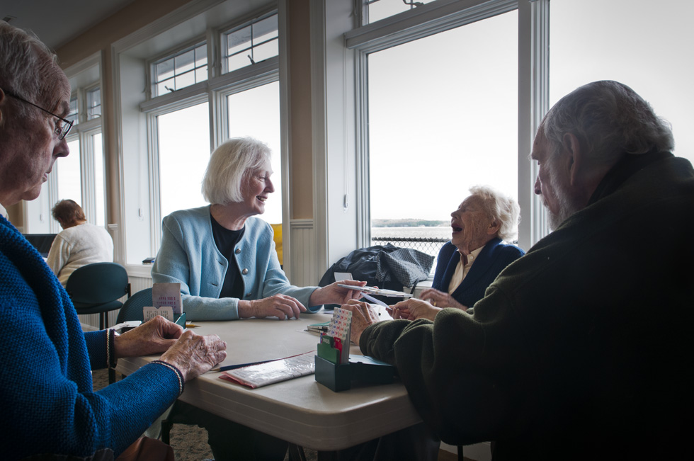 2013.05.15 - Old Saybrook, CT - Dede Brown (third from left) laughs as she is offered a deck of cards by Virginia Bundonis of Old Saybrook while playing with Ogden Bigelow (L) of Essex Meadows and Phil McNemer during a bridge tournament at the Old Saybrook Pavilion. The weekly tournament, played every Wednesday from 12-4, is sponsored by Old Saybrook Parks and Recreation and is directed by Claire Sauer of Lyme. Sauer, who started the duplicate bridge game about ten years ago says &quot;duplicate bridge is often very cutthroat,&quot; but because master points are not rewarded the Old Saybrook game has a reputation &quot;as a friendly game.&quot; Photograph by Mark Mirko | mmirko@courant.com