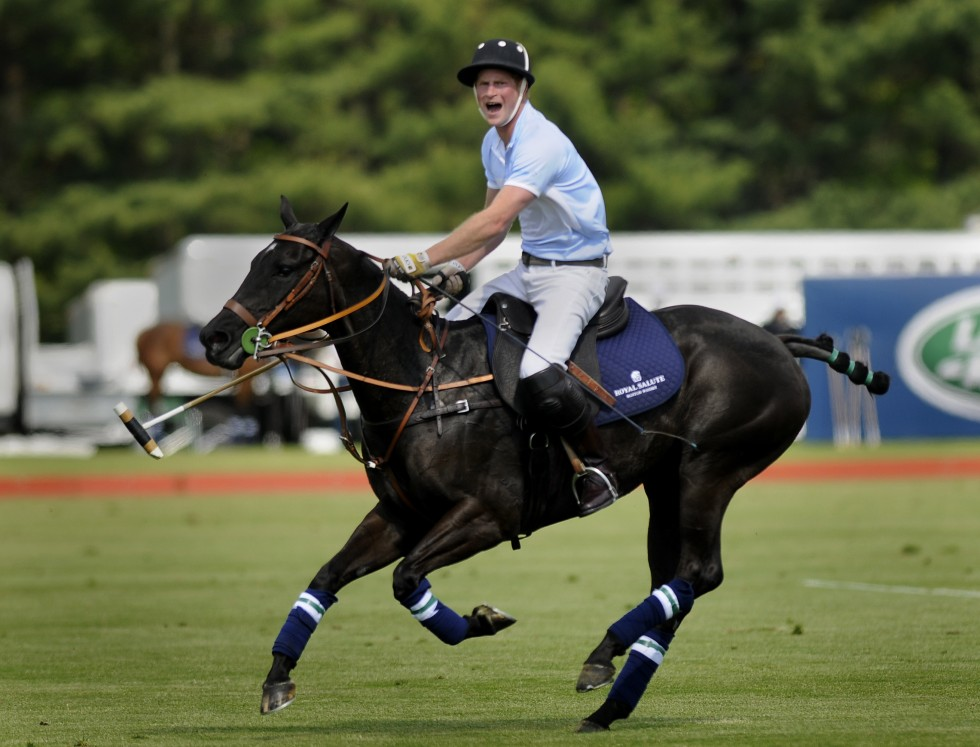 Prince Harry shouts to a teammate on the field at the Sentebale Royal Salute Polo Cup at the Greenwich Polo Club Wednesday. CLOE POISSON|cpoisson@courant.com