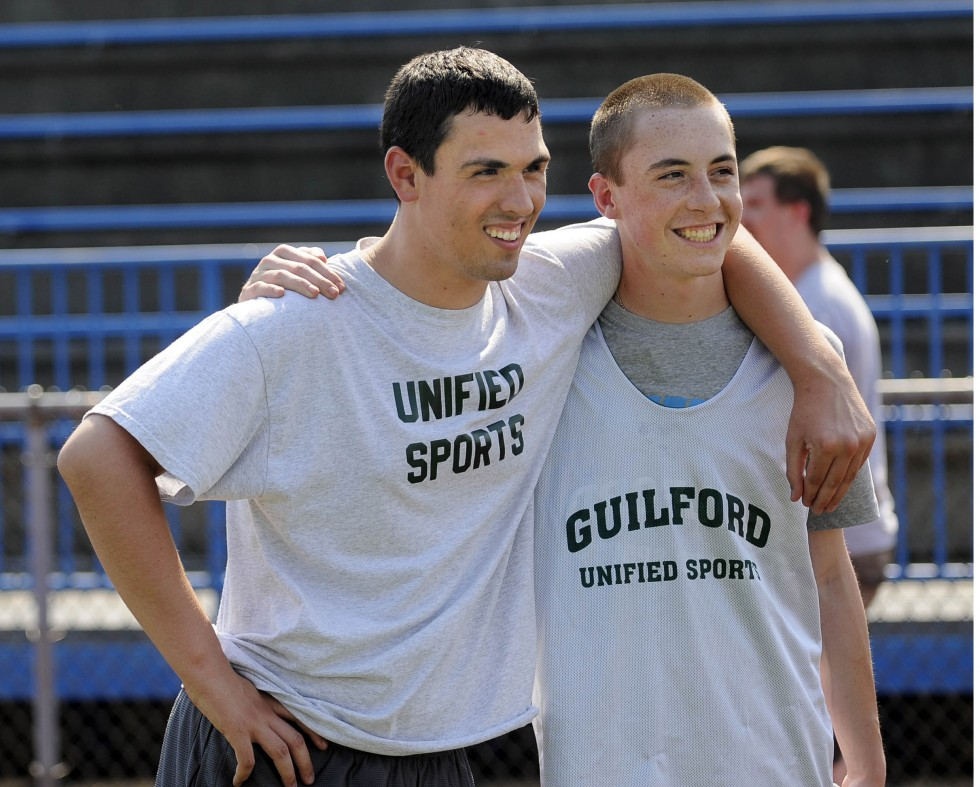 Alex Beckett, a Unified Sports athlete from Guilford High School, hangs out with his partner, Thom Heller, during the Southern Connecticut Unified Sports track meet at West Haven High School Thursday, May 30, 2013. CLOE POISSON|cpoisson@courant.com