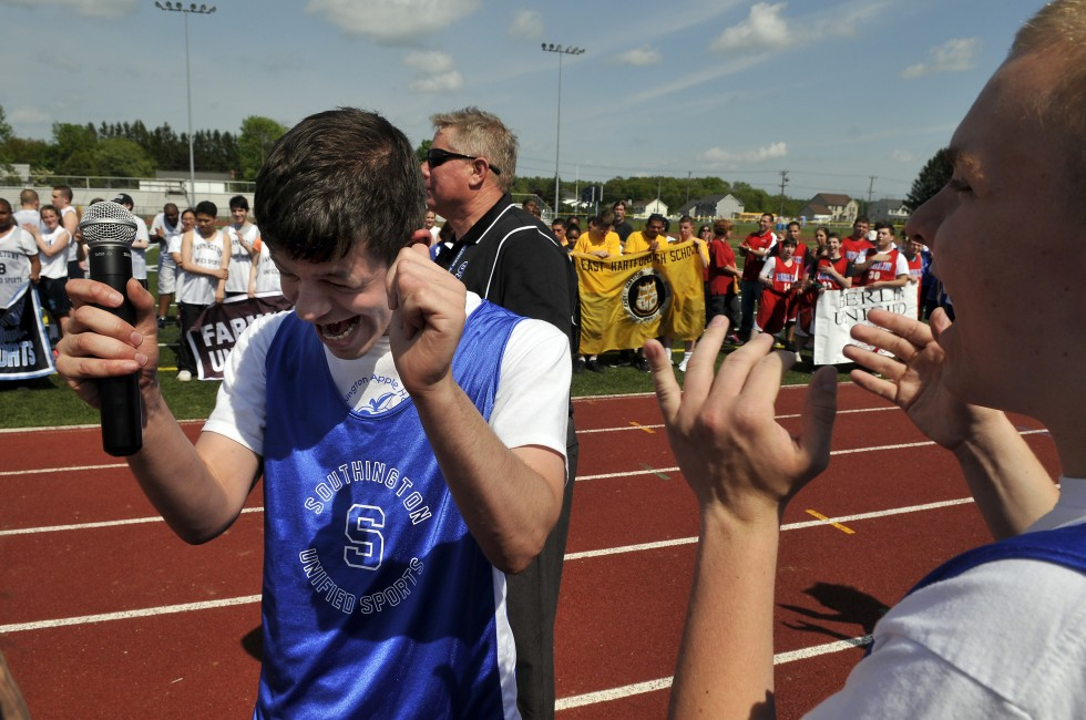 Nick Oropallo is excited after singing the National Anthem during the opening ceremonies of the Unified Sports track meet at Southington High School Monday, May 20, 2013. JOHN WOIKE | jwoike@courant.com