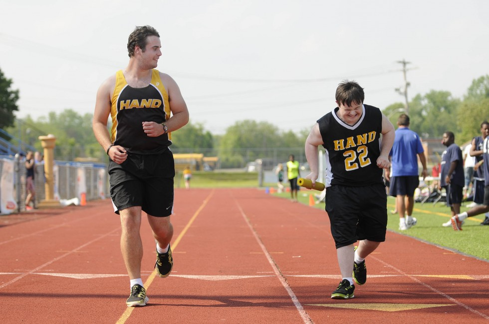 Partner Vinny Pizzagalli (left) runs with athlete Brian Murphy in the 4X100 event at the Southern Connecticut Unified Sports track meet at West Haven High School Thursday, May 30, 2013. Pizzagalli and Murphy are from Daniel Hand High School. CLOE POISSON|cpoisson@courant.com