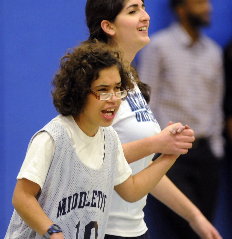 Eleventh grader, Cheyenne Summer, left, and her partner, senior Fatima Bishtawi, celebrate a basket during a Unified Sports basketball game between Middletown High School and RHAM, on Tuesday, January 22, 2013. RICHARD MESSINA | rmessina@courant.com