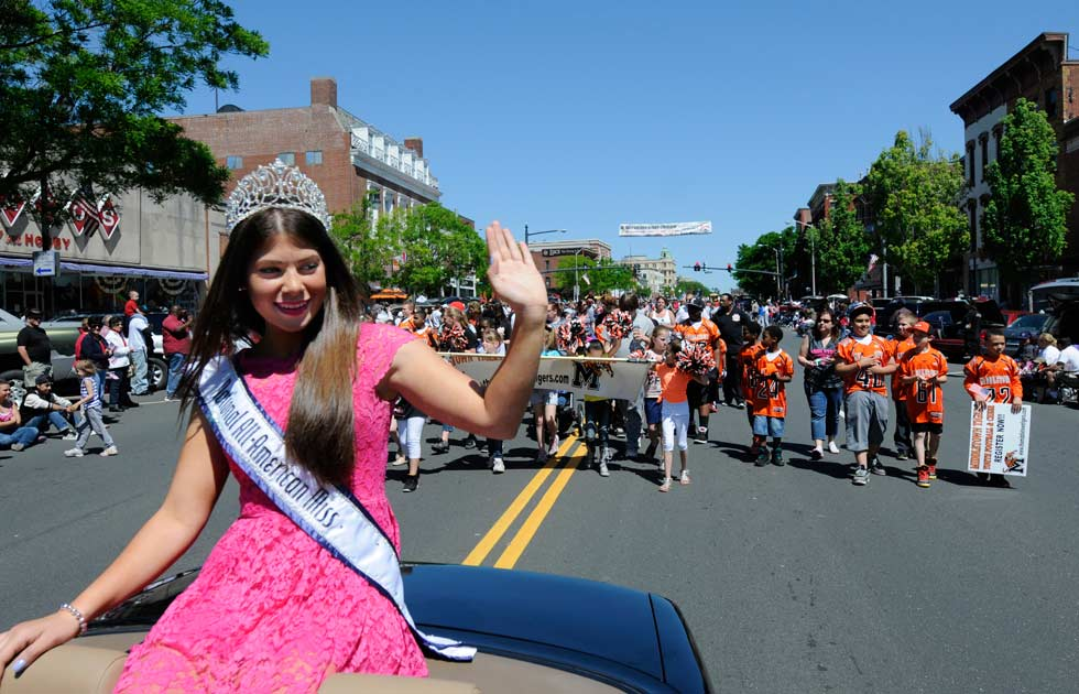 Savannah Giammarco, National All-American Miss Junior Teen wavea from her perch on the back of a convertable at the Middletown Memorial Day Parade on Main Street Monday morning.