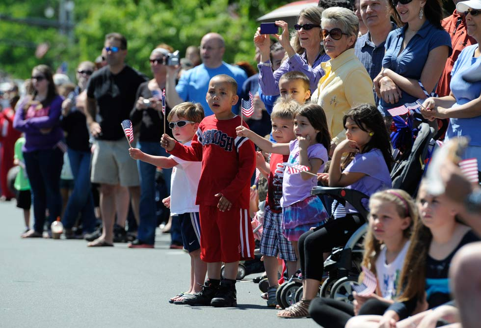 Spectators line Main Street for the Middletown Memorial Day Parade Monday morning.