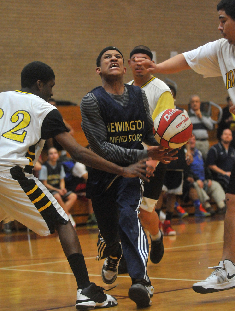 Newington Unified Basketball team's Markiet Cameron drives to the basket against the East Hartford Unified team during the Division 2 Unified State Basketball Championship at Windsor High School Friday, March 1, 2013.  BRAD HORRIGAN | bhorrigan@courant.com