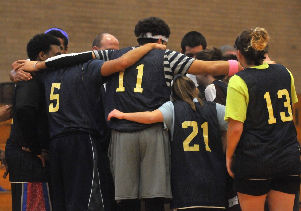 The Newington High School Unified Sports basketball team huddles before taking the court in the second half of the Division 2 Unified State Basketball Championship at Windsor High School Friday, March 1, 2013. BRAD HORRIGAN | bhorrigan@courant.com