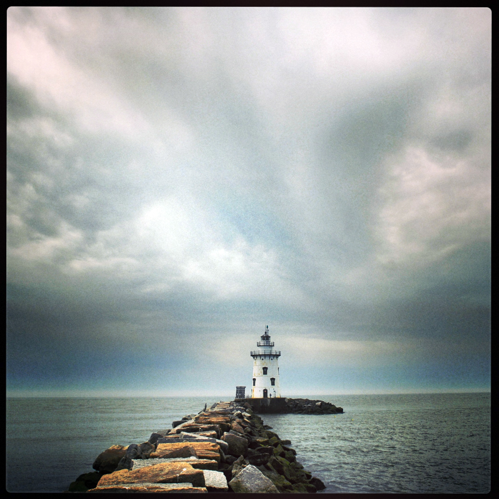 2013.05.16 - Old Saybrook, CT - Today I had the pleasure of taking a guided tour of the Saybrook Breakwater (Saybrook Outer) Lighthouse with reporter Kenneth Gosselin. BM1 Ryan Yoraschek and EM3 Jean Blanco, Aids to Navigation Team, Long Island Sound, U.S. Coast Guard, were are main tour guides. Patrick Sclafani, Public Affairs Officer with GSA New England Region was helpful with a history of the lighthouse which is up for sale, one of two lighthouses in Connecticut available.  Photo by JOHN WOIKE | woike@courant.com