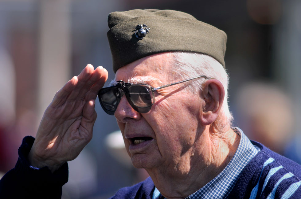 U.S. Marine Corps World War II veteran Eugene Blackwell, 89, of Manchester stands at attention and salutes the U.S. flag in Manchester during the Memorial Day parade. It turned out to be a picture-perfect day for the parade after the recent wet and cold weather system.