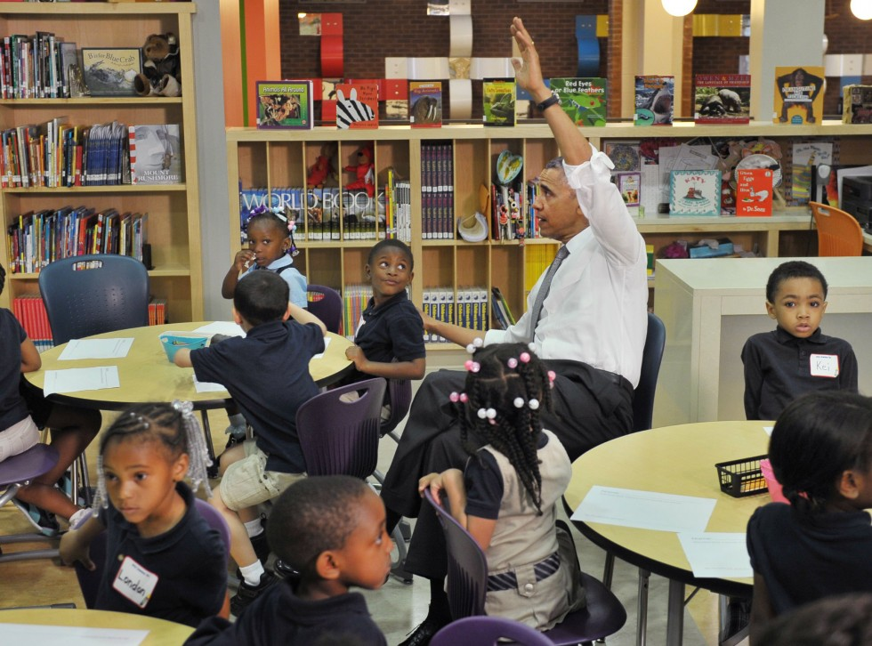 "President Barack Obama raises his hand with a question during a visit to a pre-K class at Moravia Park Elementary School on May 17, 2013 in Baltimore, Maryland. Obama is visiting Baltimore on what the administration called "" his second Middle Class Jobs and Opportunity Tour"". AFP PHOTO/Mandel NGANMANDEL NGAN/AFP/Getty"
